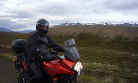 riding a motorcycle on a gravel road in Icealand
